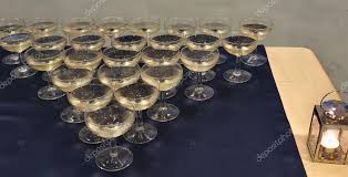 triangle shape of glasses of champagne in a romantic party photo by genoapixel