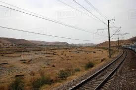Uzbekistan, Bukhara, Railway and power lines running through barren  landscape - Stock Photo - Dissolve