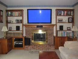 planning ideas tv mounting over fireplace with brick walls mounting tv over fireplace