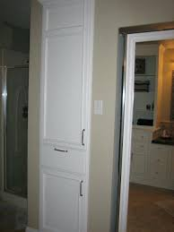 picture of upgrade small linen closet in bathroom to include hamper built plans built in linen cabinet