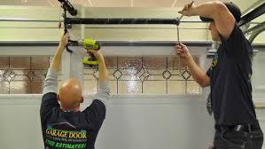 fixing garage doorDoor garage  Garage Door Spring Repair Cost Steel Garage Doors