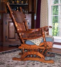 the glider rocker made of birch is very elegant looking in profile the