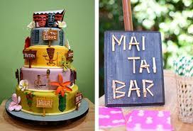 hawaiian themed wedding reception. tiki wedding cake and mai tai sign hawaiian themed reception