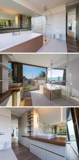 natural lighting futura lofts. In The Master Bathroom, There\u0027s A Glass-enclosed Shower, Bathtub With Wooden Surround, And Large Picture Window To Allow Plenty Of Natural Light Lighting Futura Lofts T