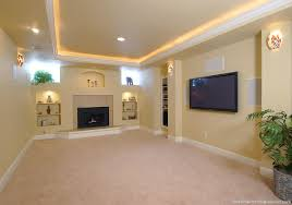 lighting basement. a nice tray ceiling with low voltage lighting around the perimeter and arched top build basement