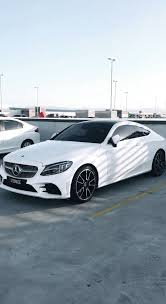 It combines dynamic proportions with reduced design lines and sculptural surfaces. White Mercedes Benz C Class Coupe C63 Mercedes Benz Coupe Luxury Cars Mercedes Mercedes Benz Cars
