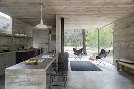 The house consists of two main spaces. At the garden level on the first  floor there is the living room connected to an open kitchen, characterized  by a long ...