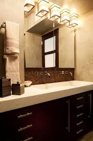 inviting above mirror wall sconce bathroom and bathroom lighting wall fixtures including brown bathroom cabinet for