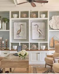 coastal designs furniture. layered rugs oversized art and symmetrical perfection of coastal touches not to mention that beautiful color on backdrop the shelving designs furniture a