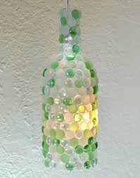 repurpose those wine bottles by turning them into glass pebble pendant lights