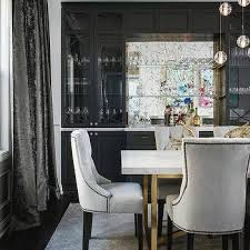 brasarble dining table with light gray velvet tufted chairs