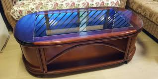 solid wood coffee table with glass