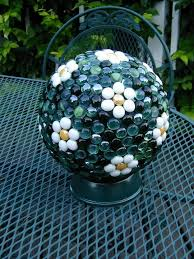 Stone Ball Garden Decoration Impressive Garden Art Made From Bowling Balls Glass Gems Used To Make Daisy