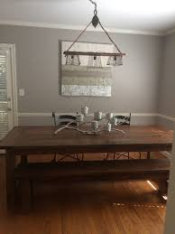 diy edison bulb light fixture over a rustic dining room table