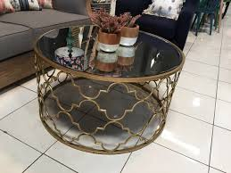 antiqued gold metal mirrored coffee table