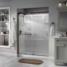 frameless contemporary sliding shower door in bronze with clear