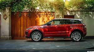 Red Range Rover Evoque in front of a ...