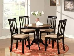 amazing black round kitchen table with centerpiece and round rug