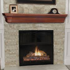 simple stone fireplace surrounds with wood mantel shelves along with antique small wooden clock and small picture