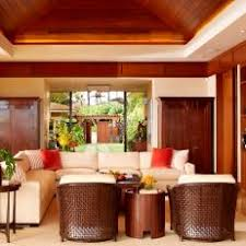 Living Room With Warm Wood Tray Ceiling