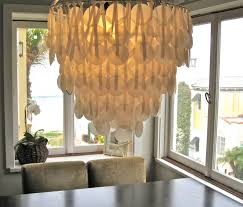 wonderful capiz shell chandelier in white above the sining table set for dining room decor ideas capiz shell chandelier capiz shell lighting fixtures