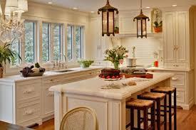 White kitchen cabinets and island design, orange accents