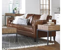 dapper upholstered sofa to have plush comfort and quiet elegance with its thick tufted bench seat