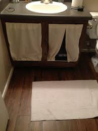Litter box in hall bathroom upstairs: A way to hide the litter boxes in a tiny  apartment. Replace the doors with small curtains.