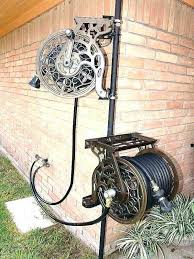 wall mount garden hose reel garden hose holder wall mount garden hose holder with wheels decorative