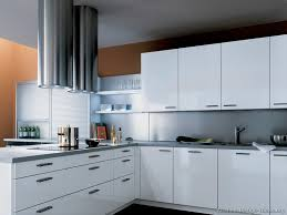 modern white cabinet doors. white cabinets, gray countertops, and sleek twin chimney hoods in stainless steel modern cabinet doors