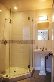 Corner shower. Frameless glass shower door.