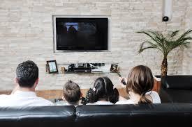 family watching plasma tv. family wathching flat tv at modern home indoor watching plasma a
