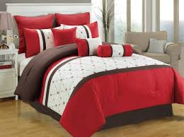 picture of 7 piece red and white embroidered bedding set