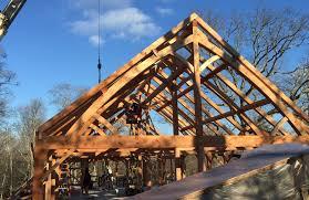 setting timber frame custom built building