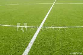 green grass soccer field. The White Line Marking On The Artificial Green Grass Soccer Field