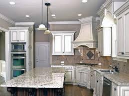 White Spring Granite With Tile Backsplash And Modern White Kitchen