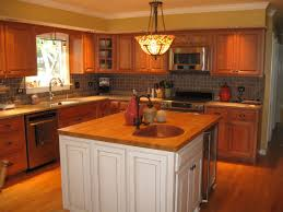 above kitchen cabinet lighting. travertine countertops soffit above kitchen cabinets lighting flooring sink faucet island backsplash shaped tile stainless teel cabinet