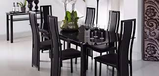 extending black glass dining table and 6 chairs noir range from harveys