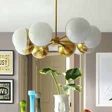 chandeliers jonathan adler meurice chandelier abbey lighting with oval spoke brass modern chandeliers for remodel