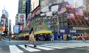 photos of and the days after the streets in times square during the normal morning rush hour are quiet as the city
