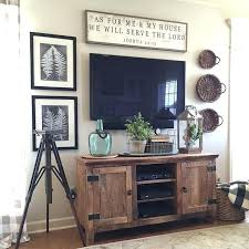 decorating around a wall mounted tv like the wood color of stand a wall mounted flat