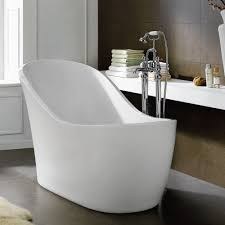 white chaise lounge shape freestanding bathtub from fiberglass using stainless steel faucet and wooden floating shelf on dark wall