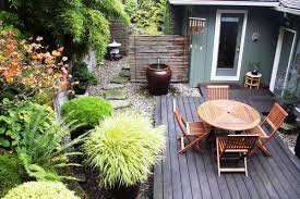 small garden landscape decorating ideas with wooden deck and outdoor furniture sets