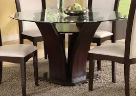 round glass dining table with dark brown wooden base on mocha fur large size