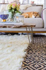 how to layer rugs like a pro via thefoxandshe