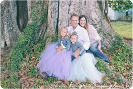 the girls really stand out in their full tulle skirts in this outdoor family photo