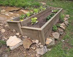 organic raised bed on a sloped yard