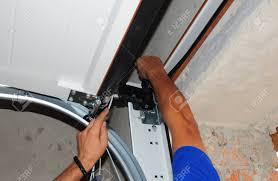 Repairman Repair Garage Door Opener. Garage Door Replacement ...
