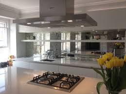 Mirrored Kitchen Cabinet Doors Transitional Kitchen With Glass Tiles Mirrored Backsplash And