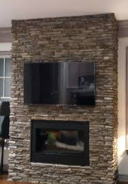 mounting flat screen tv above stone fireplace mounted on wall where